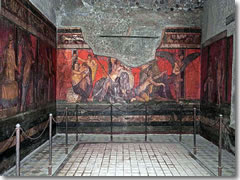 Some frescoed chambers—like this one at the Villa dei Misteri—survived the ages intact.