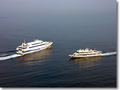 A ferry and a hydrofoil in the Bay of Naples