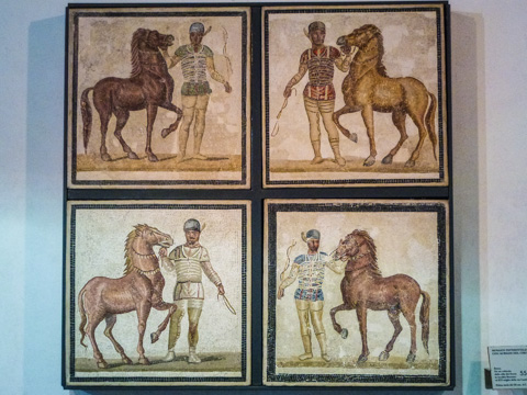 AD 3rd century mosaic showing the four, color-coded charioteer teams of the Circus Masimus.