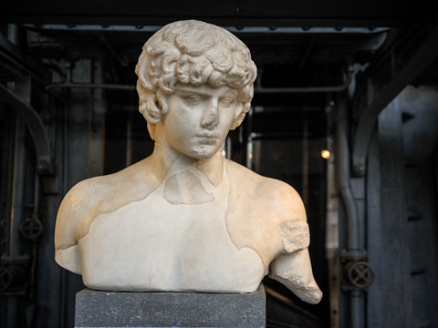 A bust of Antinous (Antinoo), Emperor Hadrian's beloved boy toy who drowned in the Nile at age 19 and was deified by the grieving emperor; in Rome's Art Center Acea - Centrale Montemartini