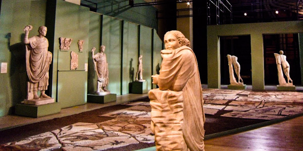Ancient Roman sculptures inside the Centrale Montemartini, including Polimnia