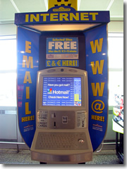 A public internet point in an airport; accepts credit cards and cash (U.S. coins, Euros, pounds, Yen, etc.)