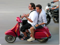 Italians talk with their hands even when their hands should be doing other, more important things, like (a) steering your scooter, and (b) hanging on to your friend who isn't steering very well.