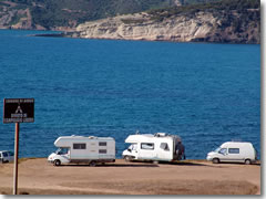 "The sign says ""no camping"" but the parked RVs say ""Hey, look: we're camping!"""