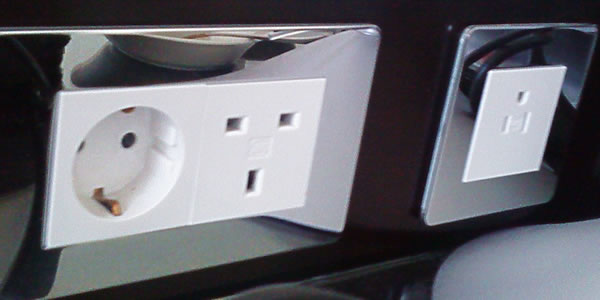 A variety of outlets in a hotel room