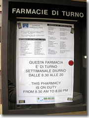 A sign outside each pharmacy in Iyaly lists the schedule for which drug stores in town are open 24 hours and on Sundays a holidays.