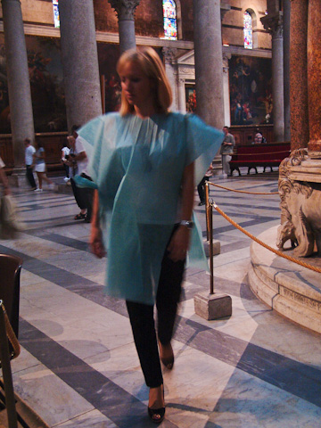 You must cover your shoulders and knees when enteirng most Italian churches; some provide the means to do so if you underdressed.