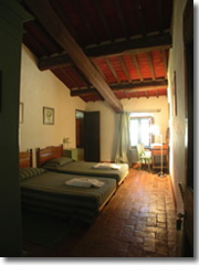 A country-comfy room at La Rignana, an agriturismo in Tuscany's Chianti region.