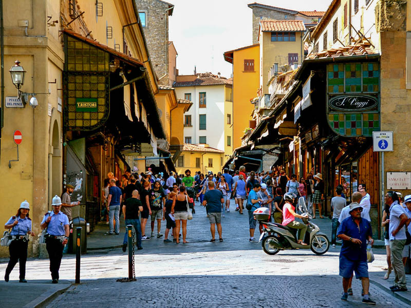 The shops lining both sides (plus the Corridorio Vasariano above on the left) make it hard to tell that Florence's Ponte Vecchio is actually a bridge. (Photo by Crash Test Mike)