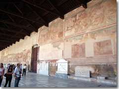 The corridors of Pisa's Camposanto are lined by Roman sarcofagi and the remains of medeival frescoes