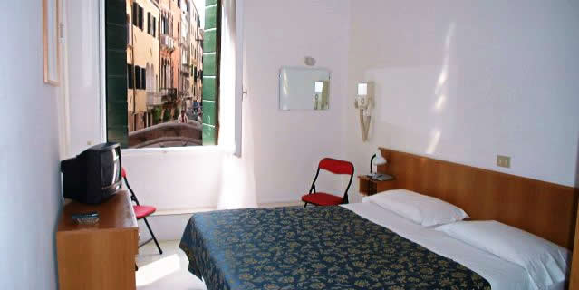 A room overlooking a canal at the Hotel Canvea, Venice