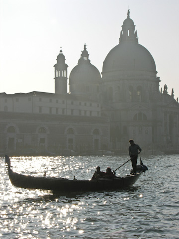 A gondolier in the Grand Canal front of Santa Maria della Salute